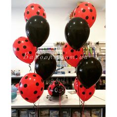 Polka dots and lady bugs. Mix of red and black latex balloons. Such a great choice for a themed birthday.