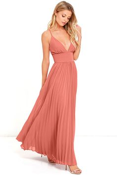 Deeper than the deep blue sea and the Grand Canyon combined ... that's how deep our love for the Depths of My Love Terra Cotta Maxi Dress is! Elegant chiffon, in a rich terra cotta hue, shapes a triangle bodice and sultry V neckline supported by crisscrossing, adjustable spaghetti straps. The fitted, pintucked waistline accentuates your figure before flowing into an accordion pleated maxi skirt. Hidden back zipper and clasp.
