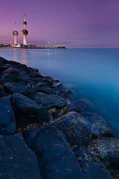 KUWAIT - Kuwait towers - The smallest tower is used to light up the other two. The globe on the tallest tower stores about a million gallons of water.