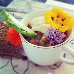 Photo credit:  Melissa Skelly Gazpacho, avocado, raw cashew sour cream, chive flowers and nasturtiums with flax crackers.