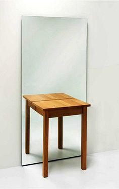 large wall mirror with a table
