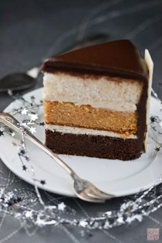 White, caramel, and chocolate cake infused with caramel buttercream and topped with chocolate ganache. http://dessertfirstgirl.com/2011/11/a-little-night-circus-cake.html?utm_source=feedburner&utm_medium=feed&utm_campaign=Feed:+typepad/dessertfirst+(Dessert+First)