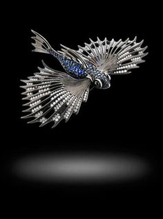 Flying Fish Brooch by Stephen Webster, 18ct white gold pavé set with 4.07 white diamonds, 0.75ct of blue sapphires and 5.94ct of green tourmalines