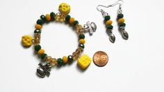Check out this item in my Etsy shop https://www.etsy.com/listing/210771529/green-bay-packers-inspired-jewelry-set