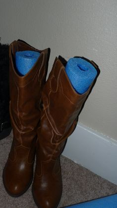 The best way to store boots so they won't flop over...just cut a styrofoam swimming noodle. (My very own idea, I might add!)