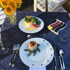 Magazine Photo Shoot in our Alaskan Gardens 2017.  Plates dinner of Alaskan Halibut medallion over black sesame rice with asparagus tips; colorful Italian pasta salad within a bread circle and 'Easter egg' radishes; dessert of Dark Chocolate Cognac Truffles & fresh berries