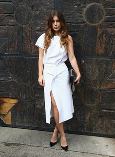 Minimal monochrome - all white style with simplistic wrap detail revealing a bronzed thigh//