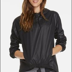 NWT Europa Pullover II in black Never worn black waterproof hoodie. Invisible zipper pockets, half zip pullover, elastic hem in front, high-low hem, and air holes under arm pits. Relaxed fit. Fabletics Tops Sweatshirts & Hoodies