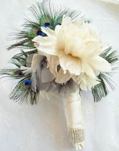 Like the ribbon tied w/brooch and feathers. If I go with the green and teal with grey... This would totally work!