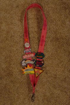 Lanyards made with Girl Scout fabric for the Girl Scouts cookie recognition awards for Bridging/Court of Awards Ceremony
