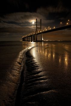 Full moon rising over the Vasco Da Gama bridge in Lisbon, Portugal. Fabulous night photography by Marco Lopes. Beautiful Moon, Beautiful Places, Night Photography, Landscape Photography, Cityscape Photography, Expressions Photography, Raindrops And Roses, Super Moon, Belle Photo