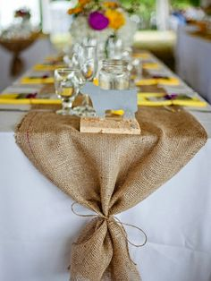 burlap table runner...tie the ends with turquoise or coral ribbon instead