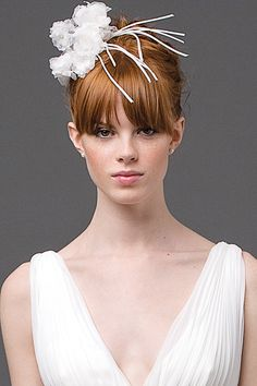 Got bangs? Play them up with a headpiece.