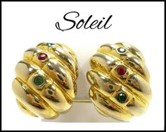 These Vintage Earrings are by Designer Soleil. They are composed of Blue, Green, and Red Crystal Rhinestones bezel-set in Gold-Finished