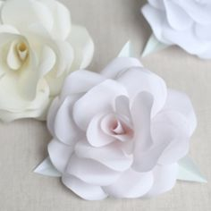 Learn how to make a paper rose for your wedding decor.