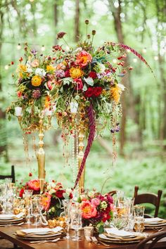 such amazing vibrant colors in this tall candelabra wedding centerpiece! - would make a gorgeous fall wedding centerpiece!