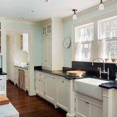 white cabinets, pale blue paint