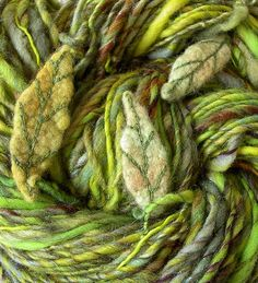 this is really gorgeous!!!...Handspun yarn in greens with felted embroidered leaves. Love!