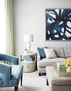 According to Gibbons, her clients were not super adventurous when it came to color (despite her love for vibrant shades), so they settled on a very light, neutral base and brought in a single color to accent throughout the space -- a deep teal.