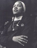Social justice causes, uniting sisters of all races, are documented at Women & Spirit: Catholic Sisters in America, a traveling American history exhibit, depicting the sisters' contributions to shaping America's social and cultural landscape. Dolores Bundy (pictured) listens intently at a 1970's religious vocation conference, showing support for Dr. Martin Luther King, Jr.'s nonviolent movement for change. (Photo courtesy of the Oblate Sisters of Providence.)