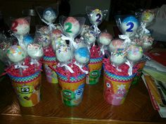 Cake pops in a cup for an easy birthday centerpiece.
