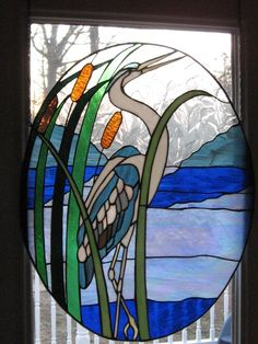 Stained glass of heron in the reeds. About 3 ft long and 2 ft wide. Oblong shape. Excellent for sun porch or as an alternative to curtains.