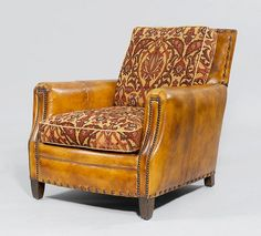 A CLUB ARMCHAIR, in the style of the 1930