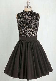 Move your feet to the stylish beat in this delightful party dress by Chi Chi London! Intricate black lace adorns the ivory bodice of this fit-and-flare twofer, accentuating its elegantly high, round neckline. With a shimmy-ready tulle-lined skirt and flattering, lightly padded top, this frock is ready to rock to the rhythm - and you don't stop!
