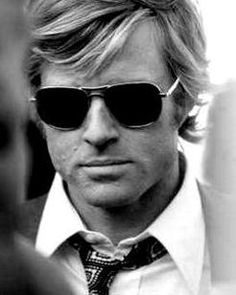Eliot (young Redford with dark shades)
