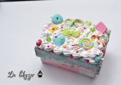 Decoden box, decorated with whipped cream and sweets.