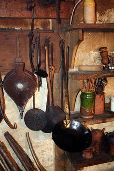 Tudor utensils hanging on wall
