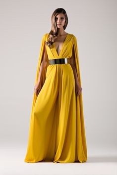 Golden yellow cape jumpsuit with plunge neck wide leg.- Michael Costello US Size Chart- Made true to size- When choosing height, include the inches of your heels- Dry clean only- Belt not included