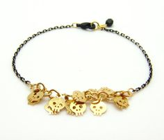 Tiny Skull Bracelet  Gold Skull Charms on Gold & Black Delicate Chain