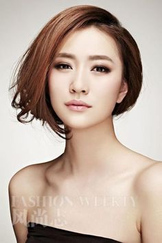 Short Asian Bob Hairstyle With Long Side Bangs