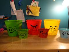 Using vinyl decals on dollar store buckets for party decor. Plastic dollar store buckets the color of the characters, then apply the .