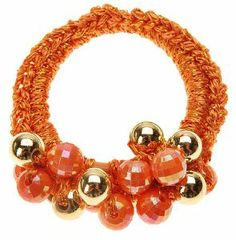 "L. Erickson Mystic Pony - Orange by L. Erickson. $18.00. Great for most hair types. Non-damaging elastic band. Dimensions: 2"" diameter. Colorful beads and baubles. Imported by L. Erickson. L. Erickson Mystic Pony is a simply charming addition to your wardrobe. Bedecked in colorful beads and wrapped in soft, metallic thread, the ponytail holder is a great, non-damaging choice to secure most hair types. Inject your style with a little sparkle and shine with this fanciful pon..."