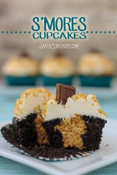 S'mores Cupcakes - Rich chocolate cake filled with graham cracker then topped with whipped marshmallow frosting, Hershey's chocolate and graham cracker crumbs! | JavaCupcake.com