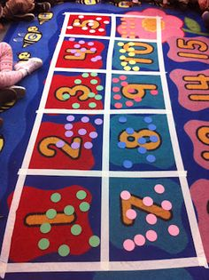 Giant 10 frame on the floor... put 10 in each box for 100th day of school