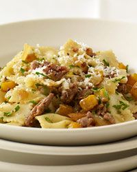 Farfalle with Spicy Sausage and Butternut Squash | This fast pasta is topped with ground Pecorino Romano.