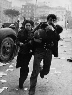 Magnum Photos-  View image only Ara Guler TURKEY. Istanbul. A family flees from the fray at taksim square on 1 may 1977.