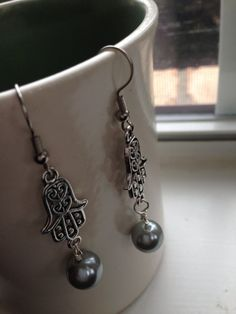 Beautiful Filigree Silver Hamsa Drop by goldenhandscreations, $10.00