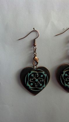 Patina heart earrings by t.dgoff,  using Patina Gilders over the Sparrow's Compass.  One of my own fave tricks is to turn a lobster claw into a design element.