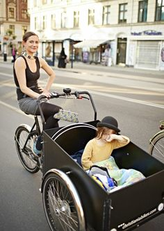 Copenhagen transport....Love the fashion statement (and that bag!) whilst riding a bike with children. Fabulous!