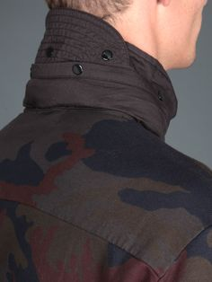 #StoneIsland follow the #camouflage #trend with this high neck sweater