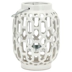 "The Celeste lantern provides a traditional accent to tabletops and shelves with a striking white color. An open cutwork trellis pattern lends dimensional allure, casting pirouetting light on transitional spaces. 6.50""Diameter x 9.50""H. Ceramic. Available in small and large. Wipe down with dry, soft cloth to clean."