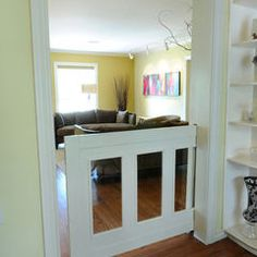 Unique child/pet gate with tempered glass.  by Greymark Construction Company, Houzz