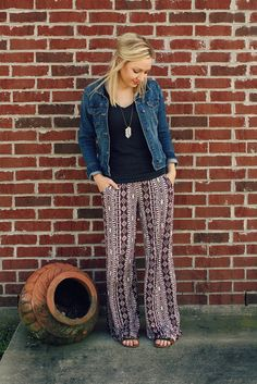 Keep your palazzo pants looking sleek by pairing with a fitted top and a denim jacket.