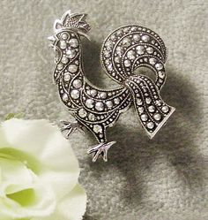 Vintage 1940's Rooster Brooch Silver and Marcasite Germany by FuzzieFrecklesandCo  https://www.etsy.com/listing/219731774/vintage-rooster-brooch-silver-and?ref=shop_home_active_5