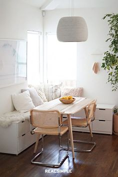 5 of the Best IKEA Hacks for Organizing Small Spaces | This idea from Molly at Almost Makes Perfect is genius for small dining spaces that double as storage. She joined together IKEA NORDI dressers to create cool modern bench seating for a breakfast nook. With hidden storage underneath, it's the perfect spot to keep napkins, tablecloths, candles, and more organized. #decorideas #homedecor #decorinspiration #realsimple #smallspaceideas #apartmentideas