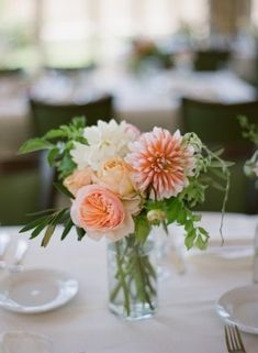 Pink-Peach-Wedding-Flowers-1  The flowers were in a peach-pink-yellow palate and consisted mostly of peonies (!!she got them in July!!), garden roses, dahlias, ranunculus, and hydrangea. When I asked her if we could incorporate olive branches to make it feel more Spanish? Who cares that there are no olive trees even remotely close to Easton, PA, she managed to get them for us! And, she kept me in check the entire time, working with me to stay within our budget.